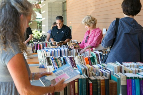 The Friends of the Idyllwild Library held its annual book sale Saturday. Many came out to scavenge for the good titles on the tables in front of the library's entrance. Photos by Jenny Kirchner