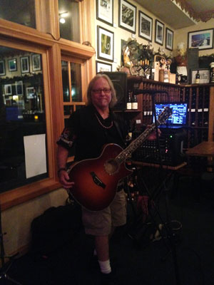Michael Britton at Idyll Awhile Wine Shoppe & Bistro on a recent Wednesday night. Britton brings 1960s and 1970s rock to Idyllwild when he can at the wine bar and also plays with Karen Blanchard at the Lumber Mill Bar & Grill from noon to 4 p.m. every Saturday and Sunday. Photo by Becky Clark