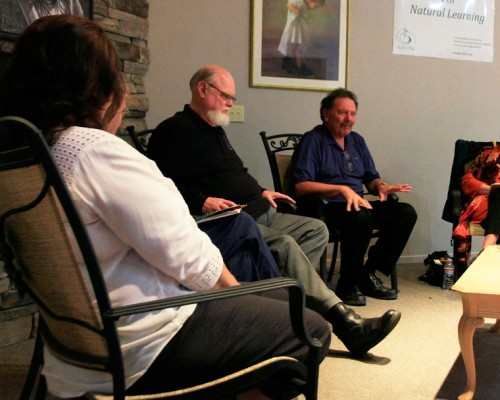 Doug Austin (center) and Geoffrey Caine (right) share stories and insights in a discussion about caretaking and caregiving held at the Caine Learning Center on Tuesday night, Sept. 8.Photo by John Drake