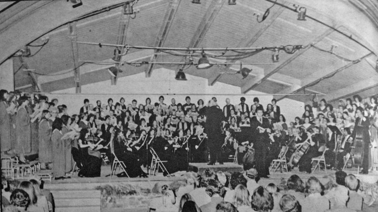"""The Idyllwild Master Chorale is pictured here in 1979 at Bowman Hall on the Idyllwild Arts campus in its annual Christmas presentation of Handel's """"Messiah."""" Robert Evans Holmes, father of present conductor Dwight """"Buzz"""" Holmes conducts.File photo"""