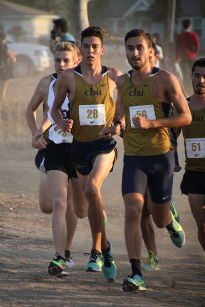 Jayden Emerson (center no. 28), of Idyllwild and freshman at California Baptist University, finished fifth in his first college cross-country race Saturday. Cal Baptist won the Lancer Invitational, easily routing three other schools. Photo by Jessica Priefer