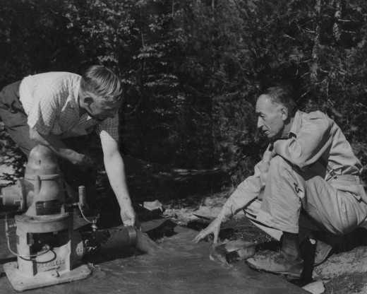 President Rollin Humber and Claude Drummond of the Fern Valley Mutual Water Company testing a new pump in 1949.File photo/Bob Gray