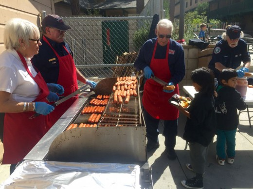 """Members of the Idyllwild Volunteer Fire Company, (from left) Rhonda Andrewson, Jim Kutsch, Paul Riggi and Jon Engel, barbecued hotdogs for students at Idyllwild School Friday. Photo by Jenny Kirchner Quilt The 12th Annual Mountain Quilters Quilt Show was held at Buckhorn Camp this weekend. Here, Barry Ogden is studying the details of the massive """"Route 66 Desert Dreaming"""" quilt. The local show was its second to last stop before ending its tour. Dawn Miller of Pine Cove contributed a section to this quilt. Her piece celebrates the famous Wigwam Motel. Photo by John Drake Acorn During Saturday's Trail of the Acorn at the Idyllwild Nature Center, Chris Adams and Maki Adams try some native foods prepared by Beatriz Torres. Several of the native dishes were prepared with acorns and native insects. Photo by John Drake"""