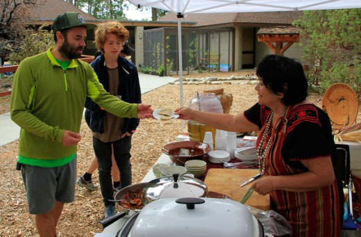 During Saturday's Trail of the Acorn at the Idyllwild Nature Center, Chris Adams and Maki Adams try some native foods which Beatriz Torres prepared. Several of the native dishes were prepared with acorns and native insects.Photo by John Drake