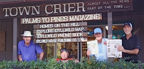 André Pilon, second from right, and three friends from the Montreal area, Michel Charette, Pierre Patoine and Réjean Côté, display a copy of the Town Crier on their recent vacation to … Idyllwild. The four amis played 36 holes a day in desert heat on their five-day trip to the Southland area. Pilon is a huge fan of Idyllwild native and pro golfer Brendan Steele. Photo by Jack Clark