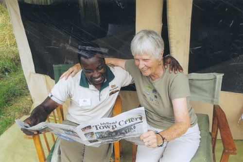 After a day on the Serengeti where she witnessed a lion capturing its prey, a bloat of hippos, a leopard with its kill and a cheetah catching a gazelle, Elaine Hoggan of Pine Cove shares her Town Crier news with safari guide Godliving during a recent visit to Tanzania.Photo by Mnoto