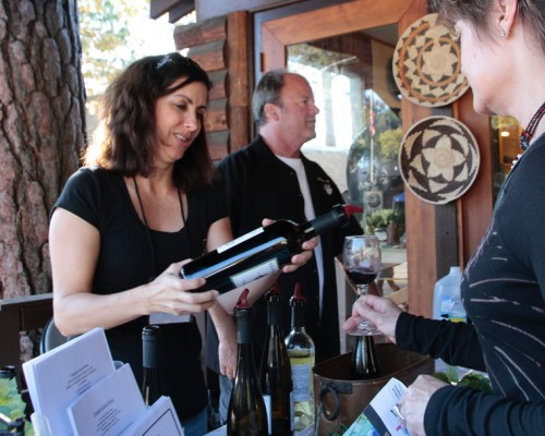 Joanne and Keith Frangipani serve white and red in front of Everitt's Minerals during this year's Wine Tasting event on Saturday.Photos by John Drake