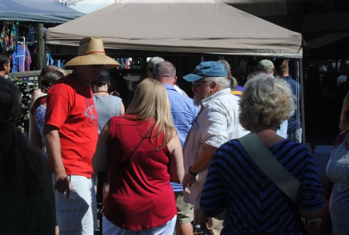Many wine tasting patrons wait for a sip of Middle Ridge's offering on Saturday's Art Walk and Wine Tasting. Photo by JP Crumrine