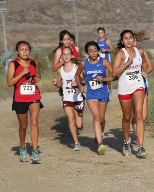 Julia Romero (far right), Idyllwild and a sophomore at Hemet High School, finished 35th out of more than 100 freshmen and sophomore runners Saturday.