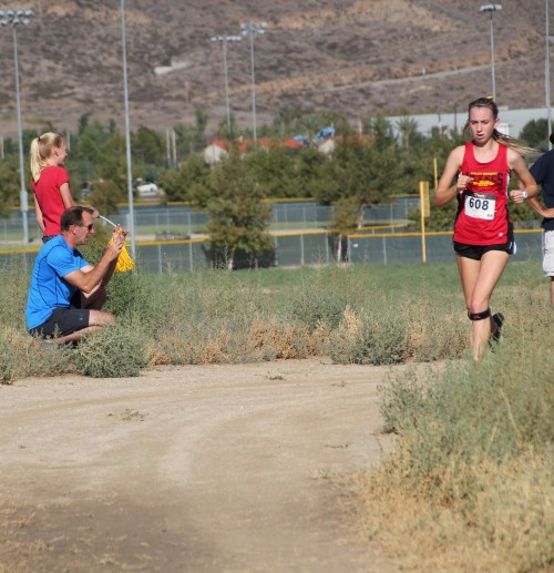 Riley Arnson, formerly of Idyllwild, is a junior at Palm Desert High School. During the race she passes her fater Lee and sister Brooke to finish sixth in the Girls 3-mile run. There were 113 girls competing in this event.