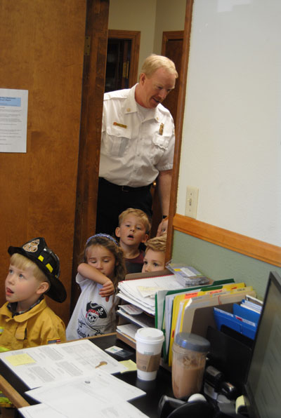 Idyllwild Fire Chief Patrick Reitz gives the kids from Lil' Critters a tour of the Idyllwild Fire Department last week.Photo by JP Crumrine