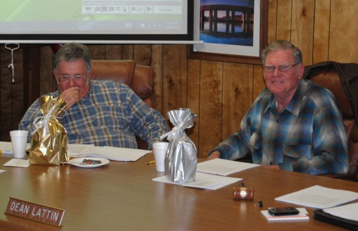 Warren Monroe (left) and Dean Lattin (right) admire the gifts of recognition for their service as directors of Idyllwild Water District. The Nov. 18 session was their last formal meeting before their terms expire in early December. Photo by JP Crumrine
