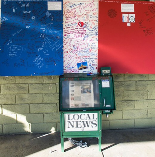Locals and visitors are sending well wishes to Paris through three posters the Art Alliance of Idyllwild located around town following the terrorist strikes that took more than 120 lives Friday, Nov. 13. Photo by Peter Szabadi