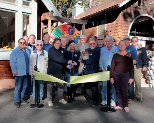 The Idyllwild Rotary helps owners Gary Kuscher, Melody Cohn and Gideon Cohn with Rainbow, to open Images Fine Art Gallery, the newest gallery on the Hill, next to Aroma with a ribbon cutting Monday morning. Rotarians who helped with the cutting include (front row, from left) Steve Espinosa, Earl Parker, Danny Richardson and Donna Elliot. In the back, from left, are Chuck Streeter, Christopher Scott, Patrick Reitz, Jan Jaspers-Fayer, Thom Wallace, Scott Fisher, Jefferey Cohen, Terry Kurr, Chuck Weisbart, Dennis Dunbar and Rick FosterPhoto by John Drake