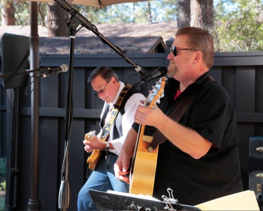 Rod Guthrey (left) and Bruce Dubuque of Southern California Sojourn playing for the lunch crowds at Ferro on Saturday.Photo by John Drake