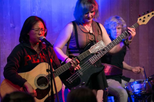 """The songwriting concert at Idyllwild Arts was Tuesday night, Nov. 10. Among the student participants were (from left) Au Jean Rhee, and Christy and Caelen Perkins, who are performing Rhee's """"Man With a Fork in a Soup of World."""" Skarlett Daniels is not pictured.Photo by Jenny Kirchner"""
