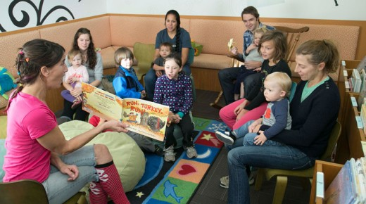 "In the spirit of Thanksgiving, Rachel Torrey (left) reads ""Run, Turkey, Run!"" at the Idyllwild Library's children's storytime Monday morning. Photo by Jenny Kirchner"