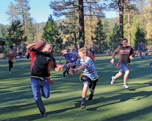 Student Zen Rose runs down teacher Brennan Priefer during the Idyllwild Middle School's annual Turkey Bowl played Thursday, Nov. 19. The teachers prevailed again this year 14-7. Photo by John Drake