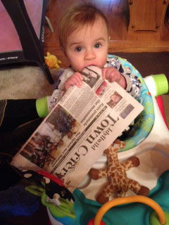 """Never too young to read the Town Crier, Monica and Richard Johnson's granddaughter Isla enjoys her weekly visit to Idyllwild to visit her Momo and Papa. Isla was in her walker (she is 7 months old). Momo had the magazine rack on the floor and Isla scooted over to the magazine rack and grabbed up the Town Crier. """"She has good taste and I guess your newspaper must taste good, too,"""" said Momo. Photo by Monica Johnson"""