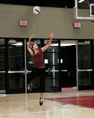Savanah Loutzenhiser serves during an adult volleyball scrimmage game at Idyllwild School Friday. Photo by John Drake