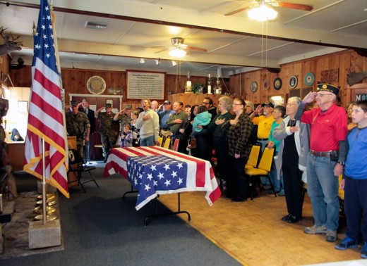 """The Veterans Day ceremony at Idyllwild's American Legion Post 800 begins with the recitation of the """"Pledge of Allegiance."""" Most of the ceremony was held indoors because of the cold temperatures Wednesday morning, Nov. 11. Photo by John Drake"""