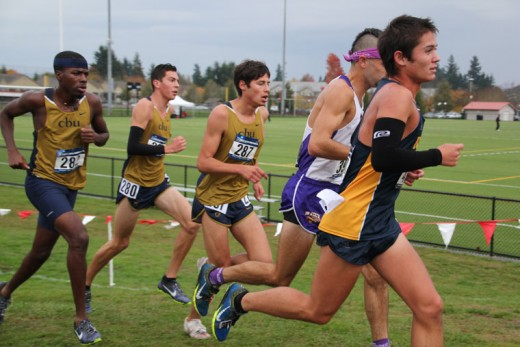"""In Saturday's rain, Jayden Emmerson (no. 280), running his first 10-kilometer race of the year, helped California Baptist University to eighth place in the West Regional of the NCAA Division II Championship Saturday. His mother, Jessica, said, """"This was the first time I've ever seen Jayden run in weather like this … I am so sad to see cross country end, but we are very proud of how far he went his freshman year."""" Photo by Jessica Priefer"""