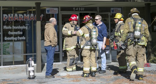 Outside the Idyllwild Pharmacy. Idyllwild Fire Chief Patrick Reitz is in center.