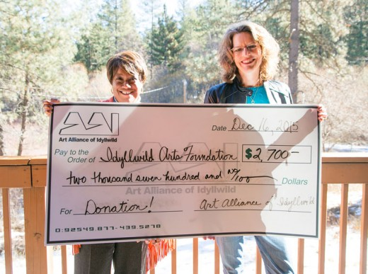 Pamela Jordan, Idyllwild Arts Foundation, accepts a $2,700 donation from Art Alliance of Idyllwild President Shanna Robb. Funds will support three different areas, whose purpose is to keep art available to Idyllwild youth. Photo by Jenny Kirchner