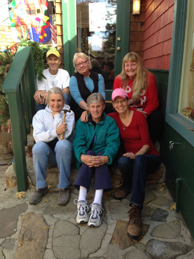 The Winter Lane Pop Up Gallery, which the Art Alliance of Idyllwild created, opens Saturday, Dec. 12. Here (front row, from left) are Erin Oneill, Veda Roubideaux and Shanna Robb, and (back row, from left) are Dave Robb, Janet McAlpine and Darcy Gerdes, the AAI members who assembled the site. Not shown is Peter Szabadi. Photo by Hans Bu