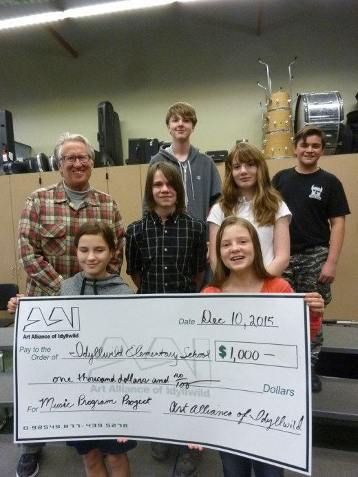 Idyllwild Music Program received $1,000 Local eighth graders, bottom row, from left, are Lauren Badger and Nicola Sabin. Middle row, from left, are Buzz Holmes (director), Dustin Ledbetter and Sage Barnett. Top row, from left, are Levi Sorensen and Nicholas Fey.