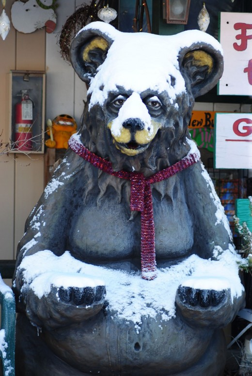 With a gesture of abundance, the bear outside the BBVA bank was satisfied with the snow covering it received the night before.