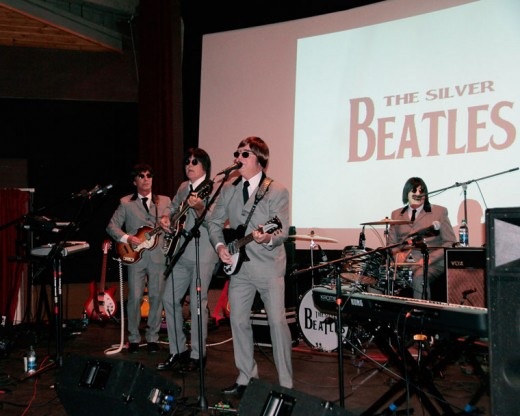 On Friday evening, tribute band The Silver Beatles entertained patrons at the Rustic Theatre. Members of the band are (from left) Barry Scott as Paul McCartney, Larry Stuppy as George Harrison, Steve Anfinson as John Lennon and Gary Long as Ringo Starr. Photo by John Drake