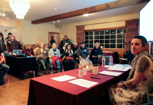 One of the speakers at the Beyond Bystander event at Rainbow Inn on Tuesday was Kaarin Elizabeth. The audience filled the open space. Photo by John Drake