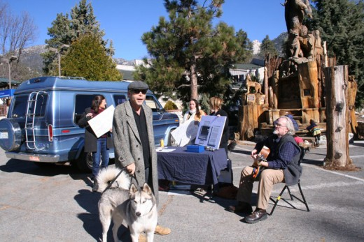 """following the week when 500 world leaders gathered in Paris to talk about climate change, Idyllwild participated in the world-wide Billion People March last Saturday at Harmony Monument. """"We're glad they're talking but now it's time for change,"""" said Richard Barker (front) with his Russian Siberian husky Stavro. Also participating (from left) were Mallory Cremin, Naomi Cohen, Jenn Quintyn and Pete Anderson on guitar. Photo by becky clark"""