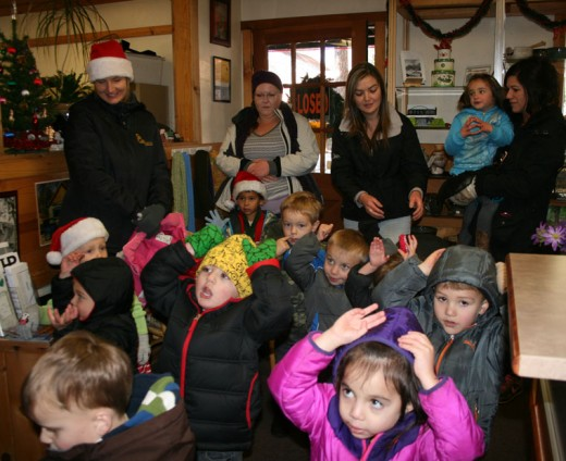 Kathy Lewis's Little Critters Daycare participants and some of their mothers visited the Town Crier office on Tuesday to treat us all to some spirited Christmas Carols. It brightened our day. Photo by Halie Wilson