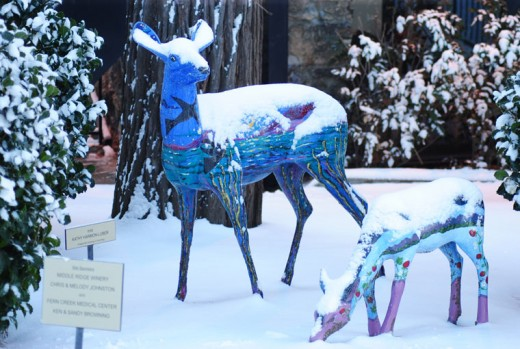 Dottie and Petito, two deer from Art Alliance of Idyllwild's Trail of the Painted Deer, enjoy the snowy weather.