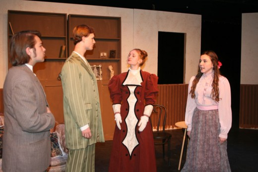 """Idyllwild Arts Academy cast members of Oscar Wilde's """"The Importance of Being Earnest"""" rehearse before the Friday, Dec. 11, opening at Rush Hall on the IAA campus. From left, are James Jones as Algernon Moncrief, Morgan Wheeler as Jack Worthing, Caroline Quigley as Gwendolyn Fairfax and Reynolds Sullivan as Cecily Cardew. Wilde's farce is directed by J. Barrett Cooper, chair of the Theatre Department, and plays from Friday, Dec. 11, through Sunday, Dec. 13. Photo by Marshall Smith"""