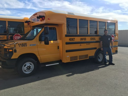 """Hemet Unified School District has purchased several new buses. Two of the buses are for special education students who attend Idyllwild School. Eric Hawksley is one of the drivers. Not shown is Michael Jupp, the other driver. The buses have been certified and are awaiting radios before being placed into use. """"We always send our newest buses to our outlining schools because they are used due to the distances and the remoteness,"""" said Alexandrea Cass, Hemet Unified School District public information officer. Photo courtesy Alexandrea Cass"""