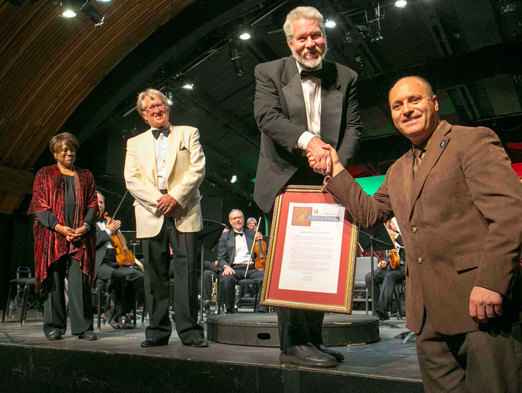 """The Idyllwild Master Chorale had a wonderful surprise during Sunday afternoon's performance at the IAF Theatre at Idyllwild Arts. For its annual holiday concert, State Sen. Jeff Stone sent his District Director Glenn Miller (right) to present a proclamation honoring the chorale for its long history of work. Accepting the honor are (from left) Idyllwild Arts Foundation President Pamela Jordon, Conductor Dwight """"Buzz"""" Holmes and IMC President Steve Kunkle. Photo by Jenny Kirchner"""