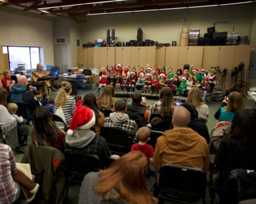 Kids and parents gather in the music room at Idyllwild School last week before winter break to watch the kindergarten class perform Christmas songs. Photo by John Drake