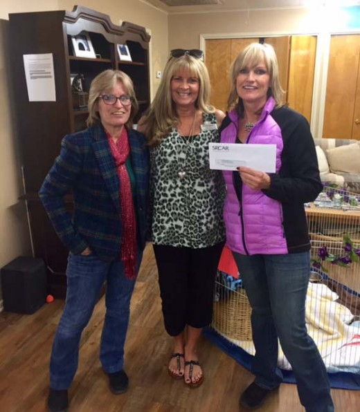 On the Friday before Thanksgiving, the Southwest Riverside County Association of REALTORS® , along with its Affiliate Committee, donated $503.20 to the Living Free Animal Sanctuary. This donation was a result of a Paint and Wine fundraiser. Accepting the donation from Kellie Tuer (center) of Generations Escrow were Tangie Miller (left), director of Administrative Services, and Sharon Caughron (right), executive director of Animal Services, both with Living Free.Photo by Diane Stumpp