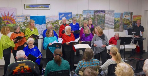 Wednesday evening, Local Color sang traditional Christmas carols and new pieces during its performance at the Idyllwild Library. Ed Hansen, on piano, and Mark Berres, on drums, accompanied the singers. Photo by Dave Pelham