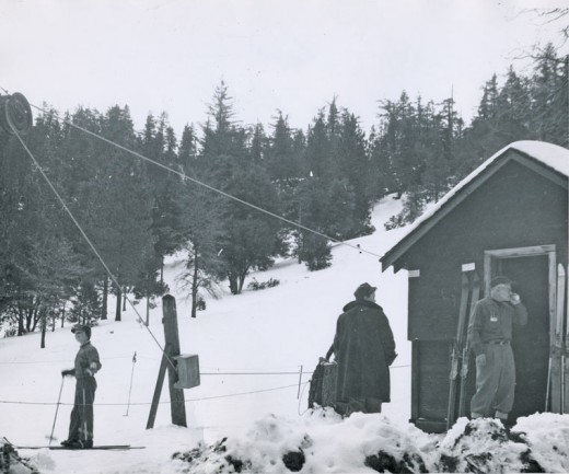Jim Henley, in the doorway, operates the ski lift at Halona Hill in Idyllwild in the 1960s. File photo