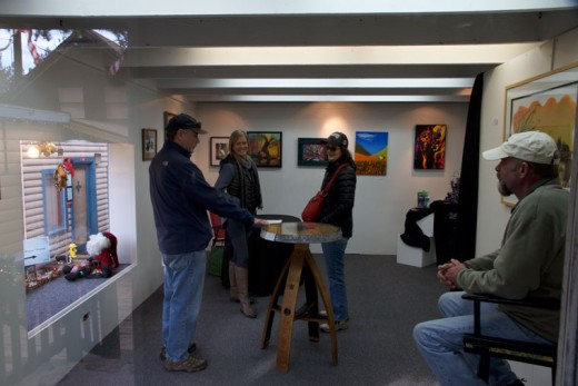 "Bob Greenamyer, Lynn Ryan, Corinne Greenamyer and Sam Watts enjoy the art at one of the Art Alliance of Idyllwild's ""popup"" galleries in the Village Lane on Friday. Photo by John Drake"