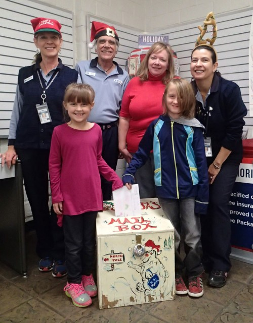 Evelyn and Carter Johnson are the first to drop their letters to Santa in the box bound for the North Pole. Santa's helpers are (from left) Sherry Kaufman, John Aussenhofer, Postmaster Kelly Gates and Christina Reitz. The mailbox will be in the Idyllwild Post Office lobby until Friday, Dec. 18, for children to send Santa their Christmas wishes. Santa allows the Town Crier to print the letters in the Christmas edition for readers to enjoy. Photo by Halie Wilson