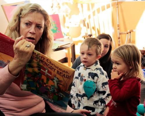 Kinsey Kretsinger and Archer Scott enjoy Idyllwild Library volunteer Virgina Lumb's seasonally themed story time reading Monday at the library. Photo by John Drake