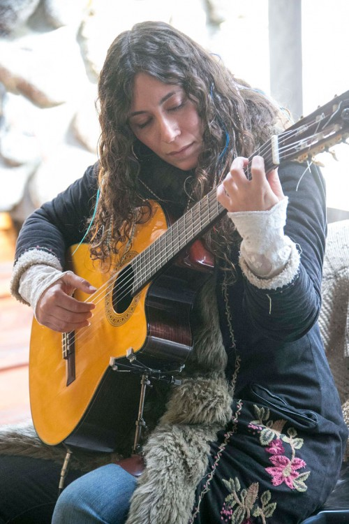Tara Rose Davison performed at Cafe Aroma Saturday afternoon, bringing classical guitar to the patrons as they dined. Photo by Jenny Kirchner