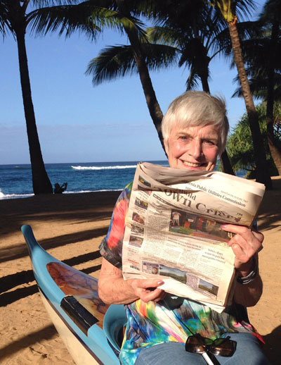 """While Chris Trout enjoys time in Hawaii, she said, """"Ready to hit the waves in my outrigger canoe on the beach in Paia, Maui, but not without my Town Crier to show me the way.""""Photo by Jay Adams"""