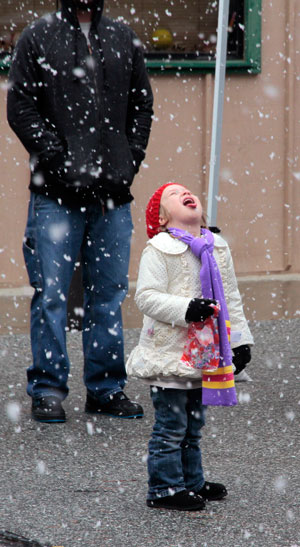 Riley Amacker enjoys Friday's snowflakes while attending the Rotary's Harvest Festival Friday at the Idyllwild School gymnasium. Photo by John Drake