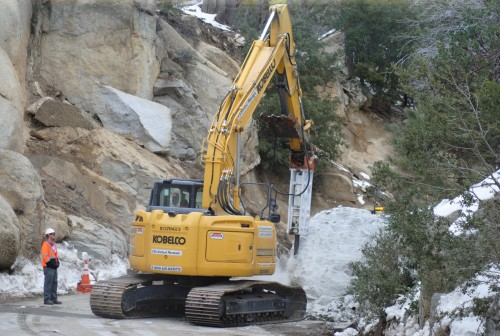 Caltrans is working to reduce the boulder on Hwy 243 in order to move it and open the roadway.